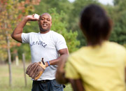 Man playing catch with his daughter